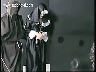 Nun slave praying for mercy is spanked by master priest on her big butt with...
