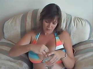 Housewife playing with ice