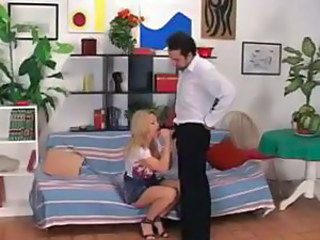 Hungry housewife gets some on her mouth from her husband on the couch