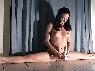 Flexible Beauty Does A Split On Her Dildo