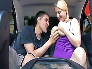Blonde pigtail babe cock rides in car