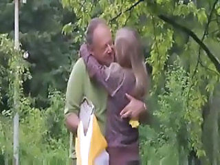 Blonde Kissing Old and Young Outdoor