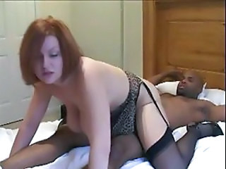 Red-haired bitch in black stockings takes it black and never goes back