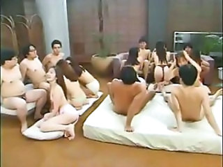 Japanese fellatio contest with a horde of chicks blowing some guys