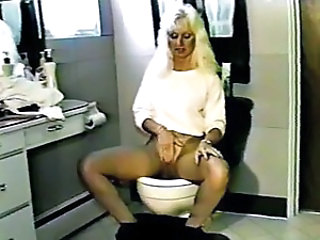 Mature Pissing Toilet