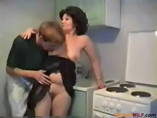Plumper brunette mom gets nailed by her son friend in the kitchen