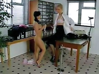 Busty brunette and blonde police women do the lesbian thing