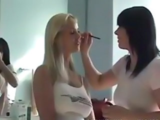 Blonde hottie Tabitha gets her make up put on in the dressing room