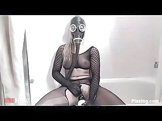 Girl In A Gas Mask Having Fun With Piss