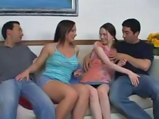 Two swinging couples mix it up on the sofa and have a four-way