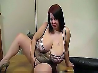 Big chubby with huge boobs takes on a black cock for a facial