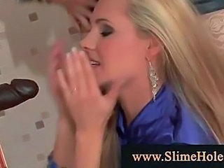 Blackcock cums on blonds through gloryhole