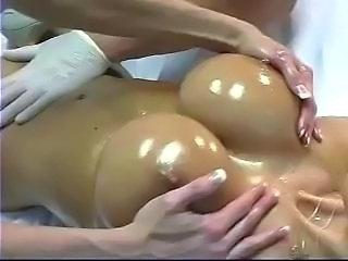 Ashley Lawrence gets rubbed down and her pussy rubbedby a female and her hair...