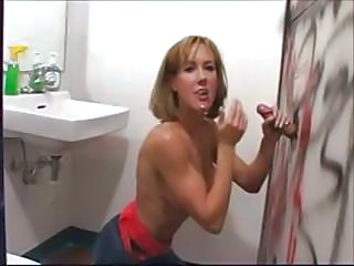 Husband Watches His Wife Suck On A Black Cock Through A Glory Hole