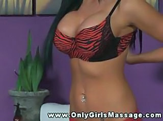 Busty masseuse gives erotic massage