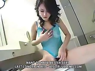 Charming brunette rubs her oiled pussy and takes cock deep into it