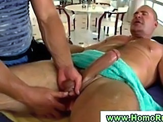 Gay masseuse massaging hunky straight man penis