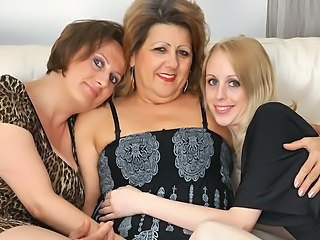 Three aged and young lesbians have fun onto the bed