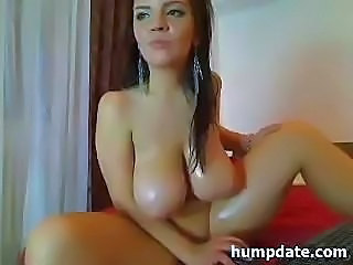 Busty babe with huge natural tits is posing and showing off on cam