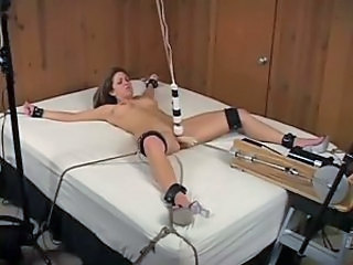 Girl tied down and toy fucked