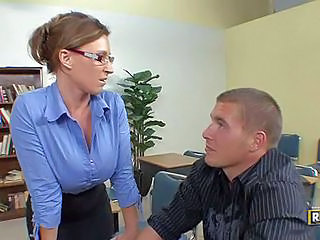 Busty Teacher Devon Lee Is A Milf With Amazing Big Boobs. Four-eyed Woman Unzips Her Blue Blouse And Pulls Down Her Bra In Front Of A Student Guy To Seduce Him Into Fucking!