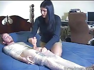 Dude in plastic wrap stroked by clothed girl tubes