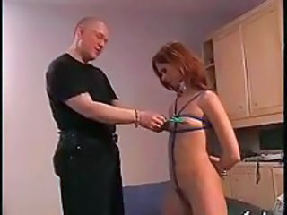 Clamps on her nipples are painful tubes