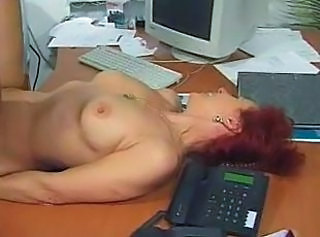 Mature Office Redhead Secretary
