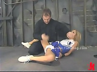 Slut is tied like a hog immobilized with hands eyes and legs fixed gets spanked and abuse