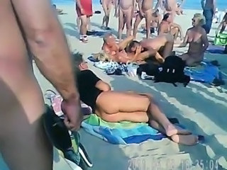 Mature Couples Having Fun on the Beach (Cap d'Agde, France)