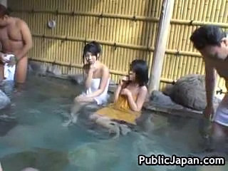 Hot Asian brunette shows her handjob skills