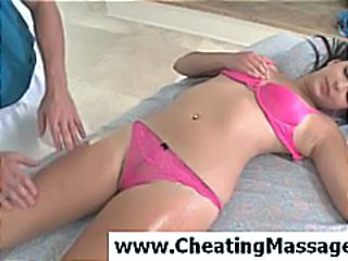 Asian cutie wearing sexy pink bra and panties gets a hot oil massage