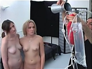 Two Gals Are Getting Tied Up And Toyed By A Fuck Machine Nailing Them
