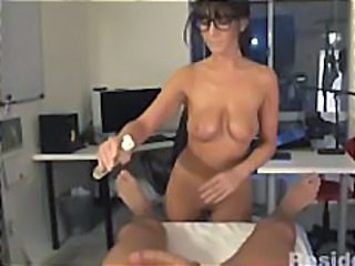 Brunette MILF gives a hot massage job and sucks his cock clean