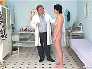 Skinny mature brunette visits the nasty old gyno doctor and gets a wide open...