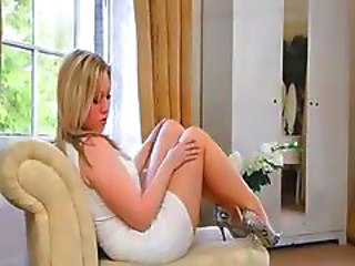 Beautiful Fairhair Bride Teasing On Sofa