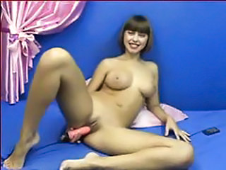Dildo fucking her snatch in video tubes