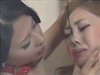 Asian Lesbian with Nose Hooks Receiving Pain and Pleasure