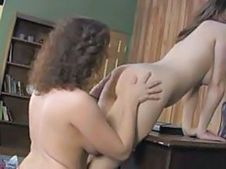 Naughty girls do strapon sex in office tubes