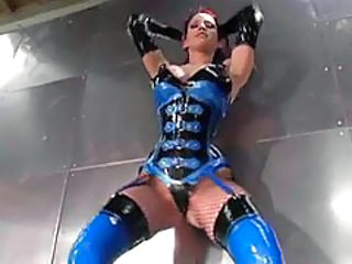 Latex outfit babe poses solo with big tits tubes