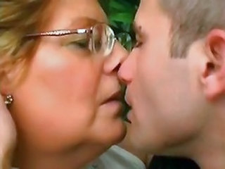 Chubby Glasses Kissing Old and Young Outdoor