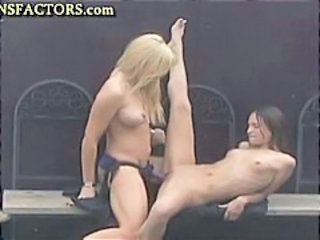 Two horny lesbians use a strapon and she rides her like a cowgirl