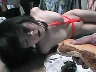 Asian sex slave in ropes gets abused on the floor