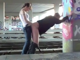 strapon by the train tracks
