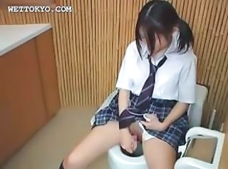 Naughty asian schoolgirl masturbates with vibrator
