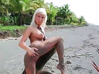 Sandy naked body on the beach tubes