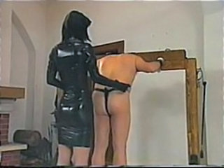 Dude is tied up and whipped as his latex clad mistress abuses him