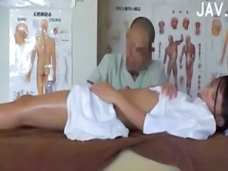 Hot asian babe gets massaged