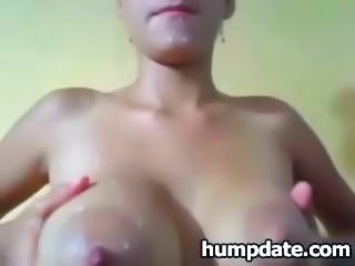 "Lactating babe plays with her boobs and milk"" class=""th-mov"