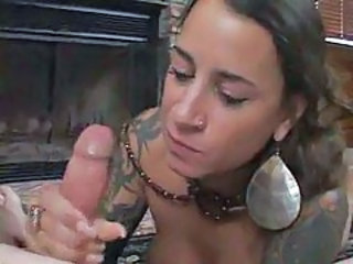 Busty milf with tats sucking on a schlong tubes